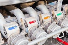 Several gasoline pump nozzles for transportation Stock Photos