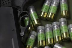 Several 12 gauge bullet cartridges and shotgun trigger Royalty Free Stock Photo