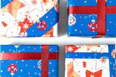 Several gift blue and white Christmas, New year colour Packed beautifully in the snow a light background closeup. Several gift blue and white Christmas, New year Royalty Free Stock Photography