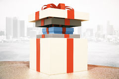 Several gift boxes. White gift box with other gift boxes inside on desktop and city background. 3D Rendering vector illustration