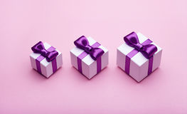 Several gifts with satin bows Royalty Free Stock Photos