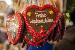 Several gingerbread hearts with Merry Christmas in German at a C stock photography