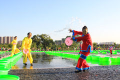 Several girls splashing water to play in the square, china Royalty Free Stock Images