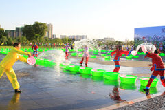 Several girls splashing water to play in the square, china Royalty Free Stock Photography