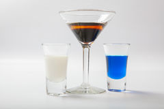 Several glasses of different drinks on bright background Royalty Free Stock Image