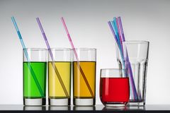 Several glasses of different drinks. Studio shot. royalty free stock images