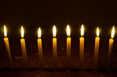 Several glowing candles stock photography
