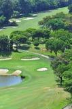 Golf Course in Penang Malaysia. Several golfer putting at the calmly beautiful Bukit Jambul Golf Course in Penang Malaysia Stock Photo