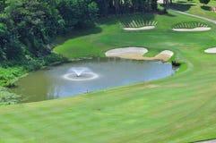 Golf Course in Penang Malaysia. Several golfer putting at the calmly beautiful Bukit Jambul Golf Course in Penang Malaysia Royalty Free Stock Image