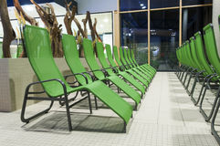Several green swimming bath sun lounger Royalty Free Stock Image