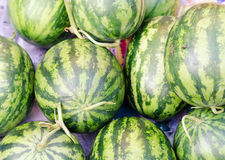 Several green watermelons on asian market place Royalty Free Stock Images