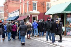 Groups of people dressed for Winter, enjoying Chowderfest, Saratoga Springs, New York, 2019. Several groups of people dressed for cold weather and the annual royalty free stock image