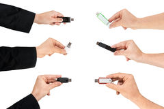 Several hands grabbing a USB flash drive. Isolated white background Royalty Free Stock Photo