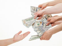 Several hands put dollars in empty palm Stock Photography