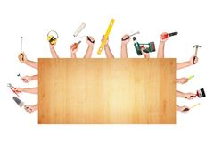 Hands with construction tools. Several hands together with different construction tools Stock Photos