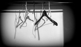 Several hangers hung in a cupboard Stock Photography