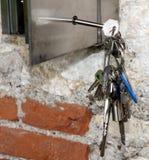 Several hanging keys and a steel safe Stock Images