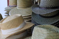 Several hats with decorative ribbon on table at open market Stock Image