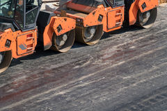 Several heavy vibration rollers at asphalt pavement works. Road repairing Royalty Free Stock Photography