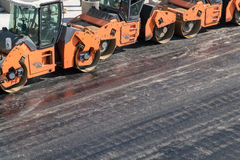Several heavy vibration rollers at asphalt pavement works. Road repairing Stock Photography