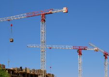 High-rise construction cranes and blue sky Royalty Free Stock Photography