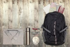 Several hiking items, on top of rustic wooden table. Stock Photo