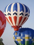 Several Hot Air Balloons Lift-Off. Several colorful hot air balloons lift on into the clear blue sky in close proximity Royalty Free Stock Image