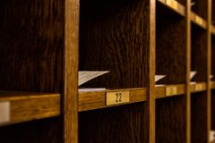 Several hotel card keys in a cabinet. Several hotel card keys in a wooden cabinet Royalty Free Stock Photo
