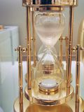 Several hourglass close up. Hourglass on a gold stand with white sand close-up royalty free stock photography