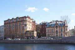Several houses on the river bank. Several city houses on the river bank Royalty Free Stock Images