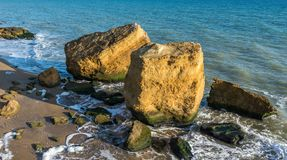 Several huge limestone stones by the sea. Few limestone stones on a Sunny autumn day on the seashore near the village of Fontanka, Odessa region, Ukraine royalty free stock photo