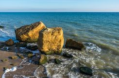 Several huge limestone stones by the sea. Few limestone stones on a Sunny autumn day on the seashore near the village of Fontanka, Odessa region, Ukraine stock photography