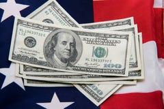 Several hundred dollars on USA flag. Close-up of several hundred dollars on USA flag Royalty Free Stock Image