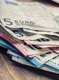 Several hundred euro banknotes stacked by value. Euro money concept. Euro banknotes. Euro money. Euro currency. Banknotes stacked Royalty Free Stock Photography