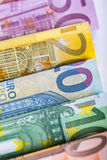 Several hundred euro banknotes stacked by value. Euro money concept. Rolls Euro  banknotes. Euro currency. Stock Photo