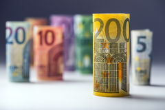 Several hundred euro banknotes stacked by value. Euro money concept. Rolls Euro  banknotes. Euro currency. Royalty Free Stock Photography