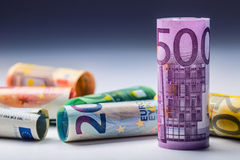 Several hundred euro banknotes stacked by value. Euro money concept. Rolls Euro  banknotes. Euro currency. Royalty Free Stock Photos