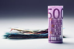Several hundred euro banknotes stacked by value. Euro money concept. Rolls Euro  banknotes. Euro currency. Stock Photography