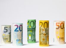 Several hundred euro banknotes stacked by value.Rolls Euro bankn. Different Euro banknotes from 5 to 500 Euro Royalty Free Stock Photos