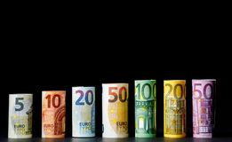 Several hundred euro banknotes stacked by value.Rolls Euro bankn. Different Euro banknotes from 5 to 500 Euro Royalty Free Stock Photo