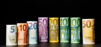 Several hundred euro banknotes stacked by value.Rolls Euro bankn. Different Euro banknotes from 5 to 500 Euro Stock Photos