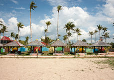 Several huts on the beach used for relaxation and shelter. Several huts on the beach used for relaxation and shelter from the sun with palm trees at the Stock Image