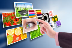 Several images and hand. Stock Photo