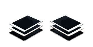 Several iPad's Stacked And Isolated On White. Background Stock Photography