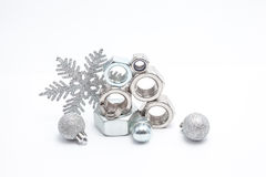 Several iron bolts and christmas balls Stock Photography
