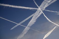 JET AIRCRAFT VAPOUR TRAILS IN CLEAR BLUE SKY. SEVERAL JET AIRCRAFT VAPOUR TRAILS CRISS CROSSING IN CLEAR BLUE SKY Stock Images