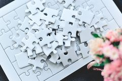 Several jigsaw puzzles are placed in a white jig. Like Harmony i royalty free stock images