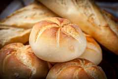 Several kaiser rolls and baquette. Stock Photo