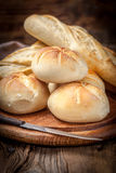Several kaiser rolls and baquette. Royalty Free Stock Photo