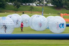Several Kids Roll Around In Large Zorbs At Summer Festival Royalty Free Stock Image